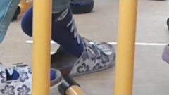 Playful Female In Blue Socks At School Under Chair