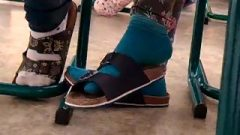 Shoeplay At College Under Desk In Blue Socks
